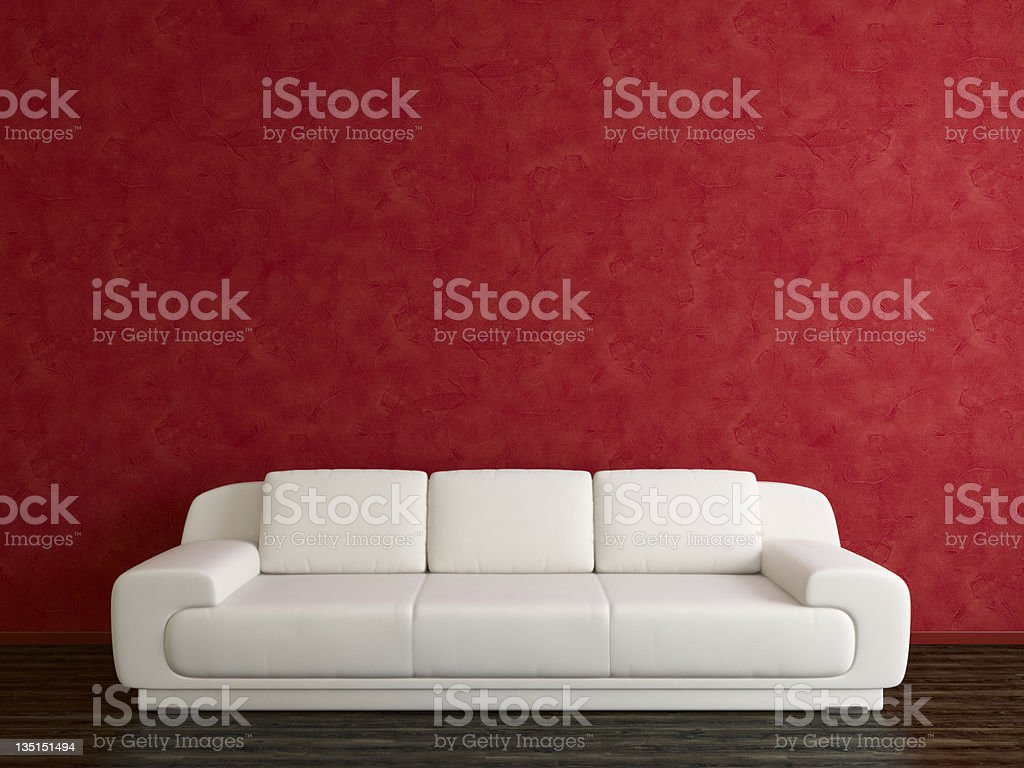 White sofa and red stucco wall stock photo