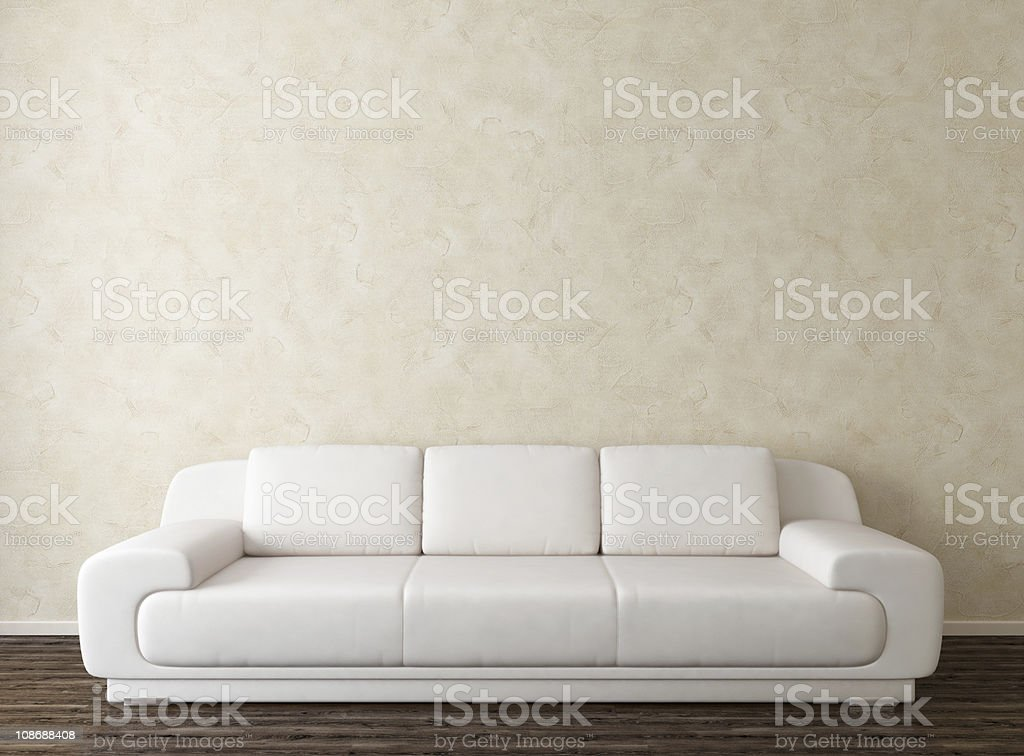 White Sofa and Stuuco Wall stock photo