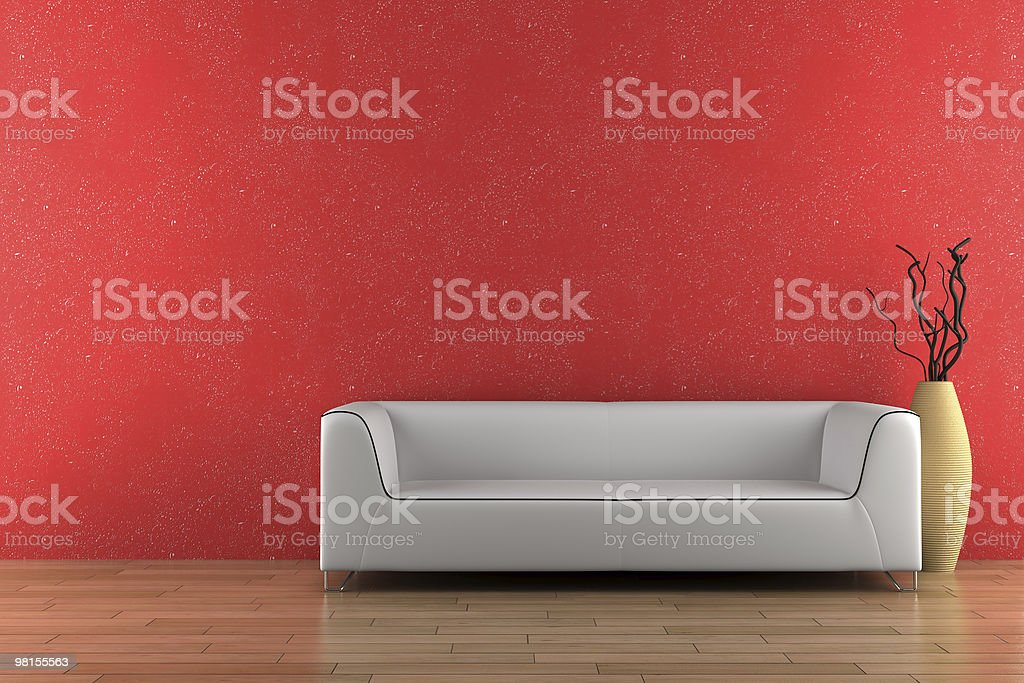 white sofa and vase in front of red wall royalty-free stock photo