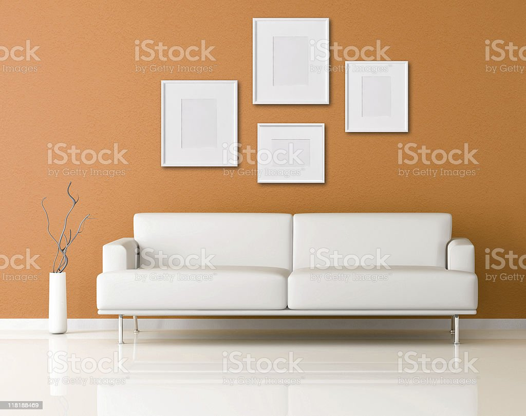 white sofa in a orange living-room royalty-free stock photo