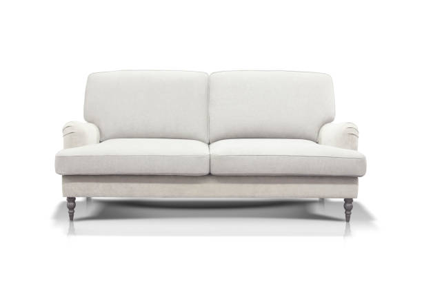 White sofa isolated on white background White modern luxurious sofa isolated on white background, front view. sofa stock pictures, royalty-free photos & images