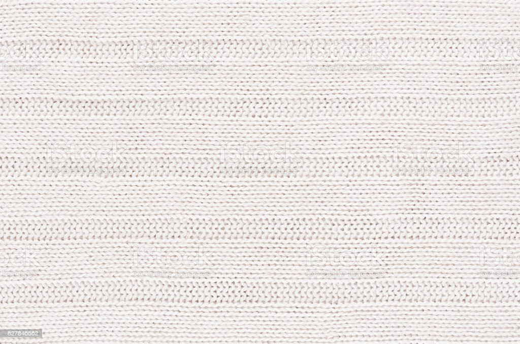 White soft knitted fabric texture with horizontal strips wale.