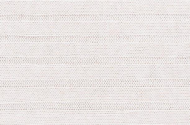 白色柔軟的針織的面料紋理以橫條狀甘文維。 - 針織品 個照片及圖片檔