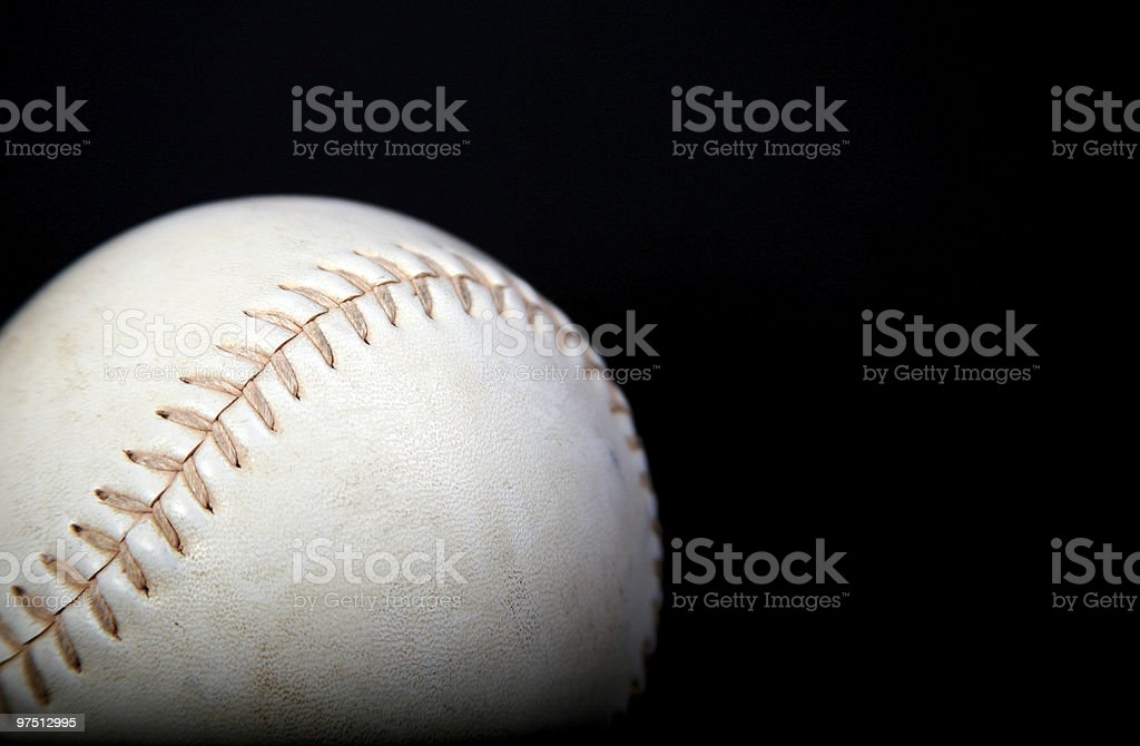 white softball with black background royalty-free stock photo