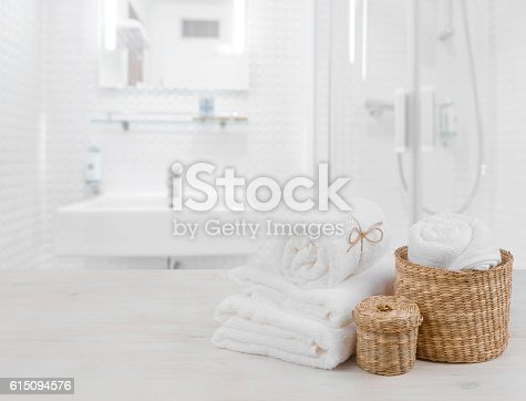 618327092istockphoto White spa towels and wicker baskets on defocused bathroom interior 615094576