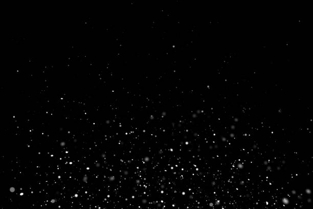 White sparkles on black background White particles on black background with copy space. glittering stock pictures, royalty-free photos & images