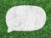 istock white speech bubble on green grass 516619777
