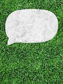 istock white speech bubble on green grass 516619917