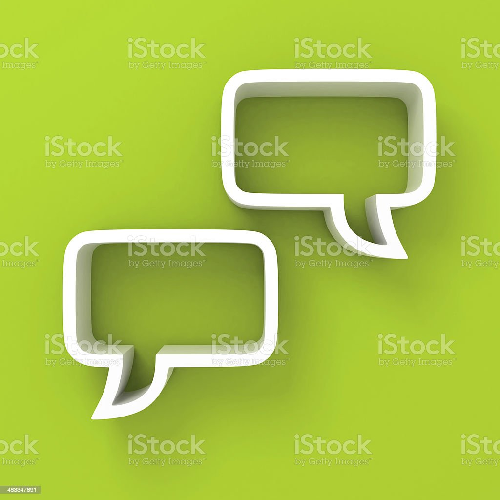 white speech bubbles on green background stock photo