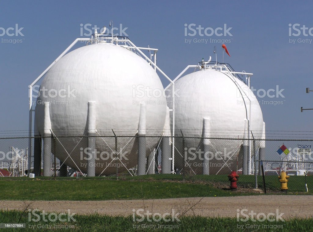 White sphere storage tanks in a field royalty-free stock photo