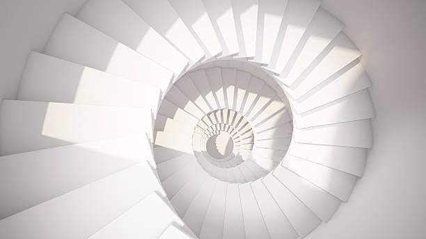 White spiral stairs in sun light abstract interior stock photo