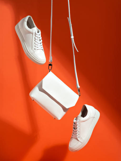 white sport shoes and small bag. - levitazione foto e immagini stock