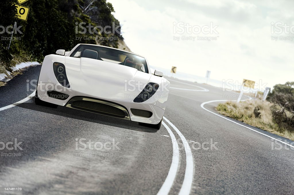 White sports car on coastal road at daytime stock photo