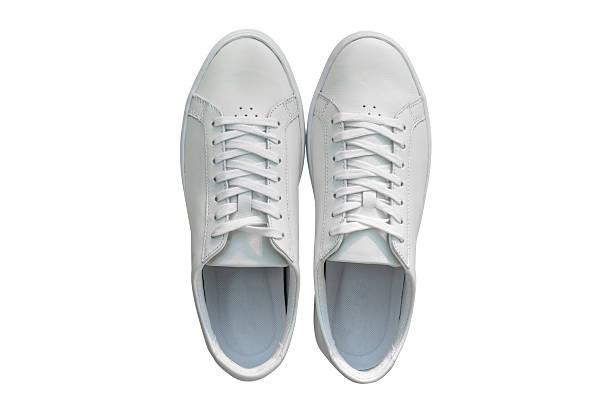 white sports shoes for men isolated on white background - schnürsenkel stock-fotos und bilder