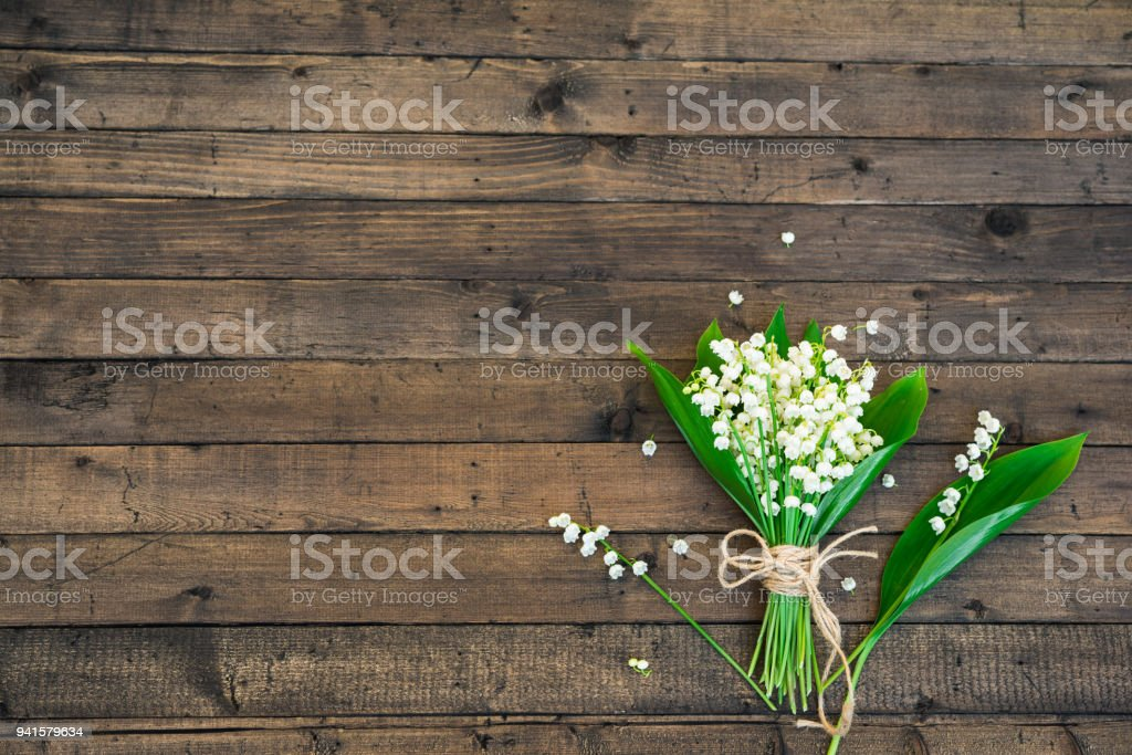 White Spring Flowers. Bouquet of Lily of the valley on a Dark Brown...