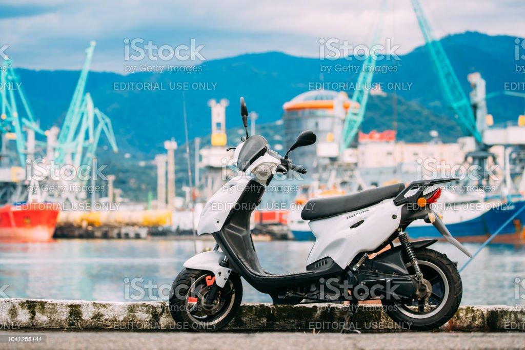 White Sprint Motor Honda Scooter Motorbike Motorcycle Bike Parked...