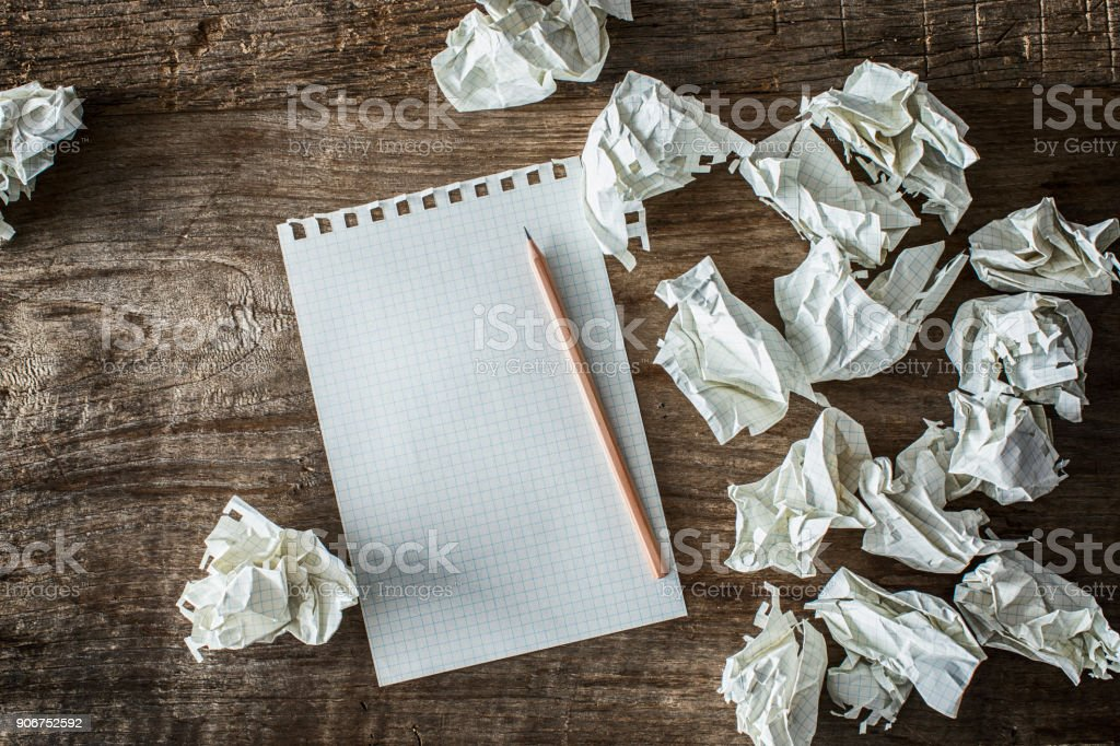 White square paper, pencil and wasted papers on wooden back ground royalty-free stock photo