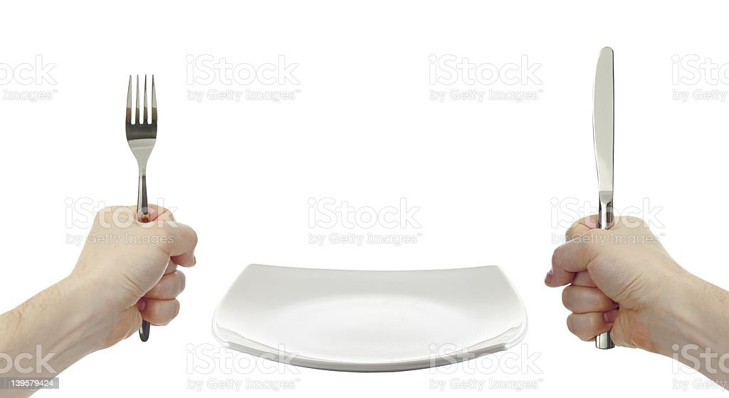 white square plate, knife and fork cutlery in hands isolated stock photo