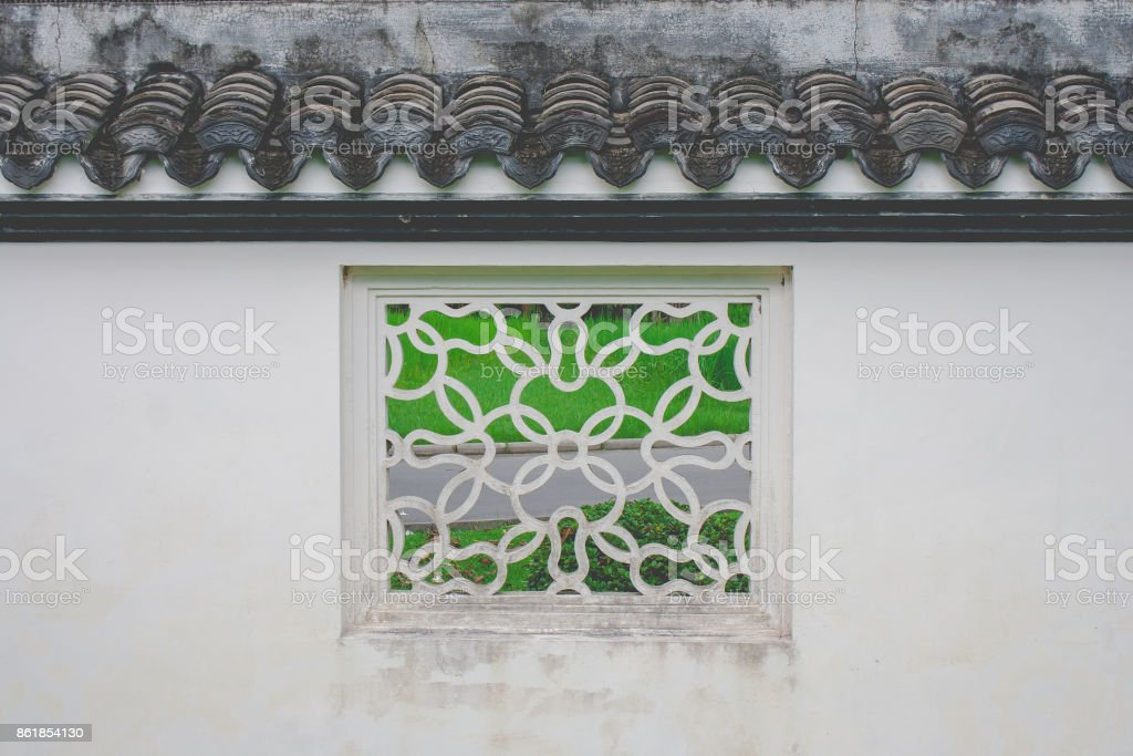 White square window Chinese style old fashioned decoration with green natural background at Chinese garden. stock photo