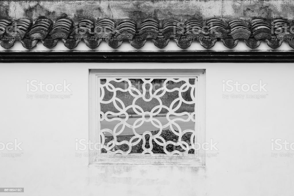 White square window Chinese style old fashioned decoration with green natural background at Chinese garden. (Black and White filter effect) stock photo