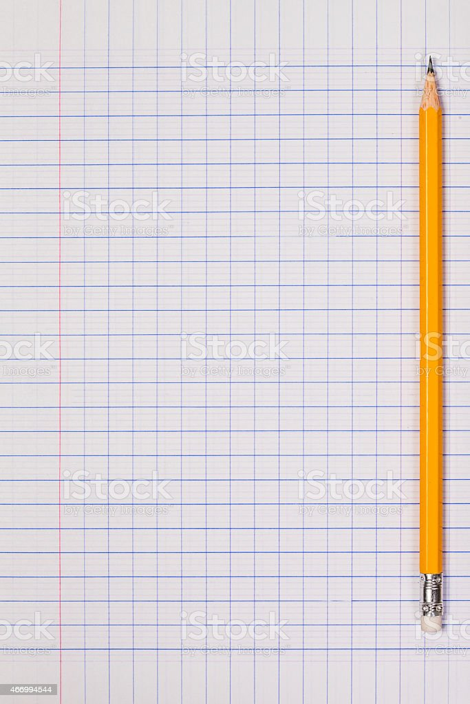 White squared paper sheet background with pencil stock photo