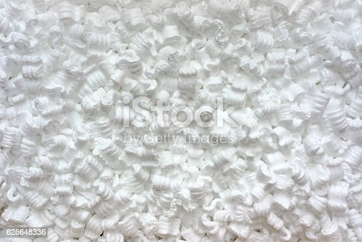 White S-shaped, anti-static, polystyrene packing peanuts shown from above.