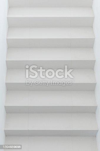 1048837520 istock photo White staircase in light  interior 1204659698
