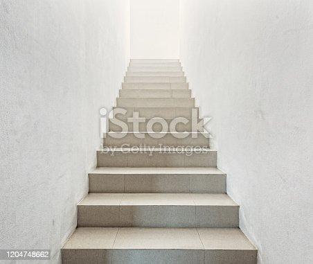 1048837520 istock photo White staircase in light  villa  interior 1204748662