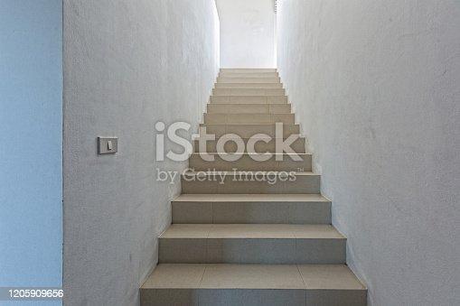 1048837520 istock photo White staircase in light  villa  interior 1205909656