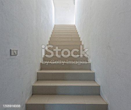 1048837520 istock photo White staircase in light  villa  interior 1205916333