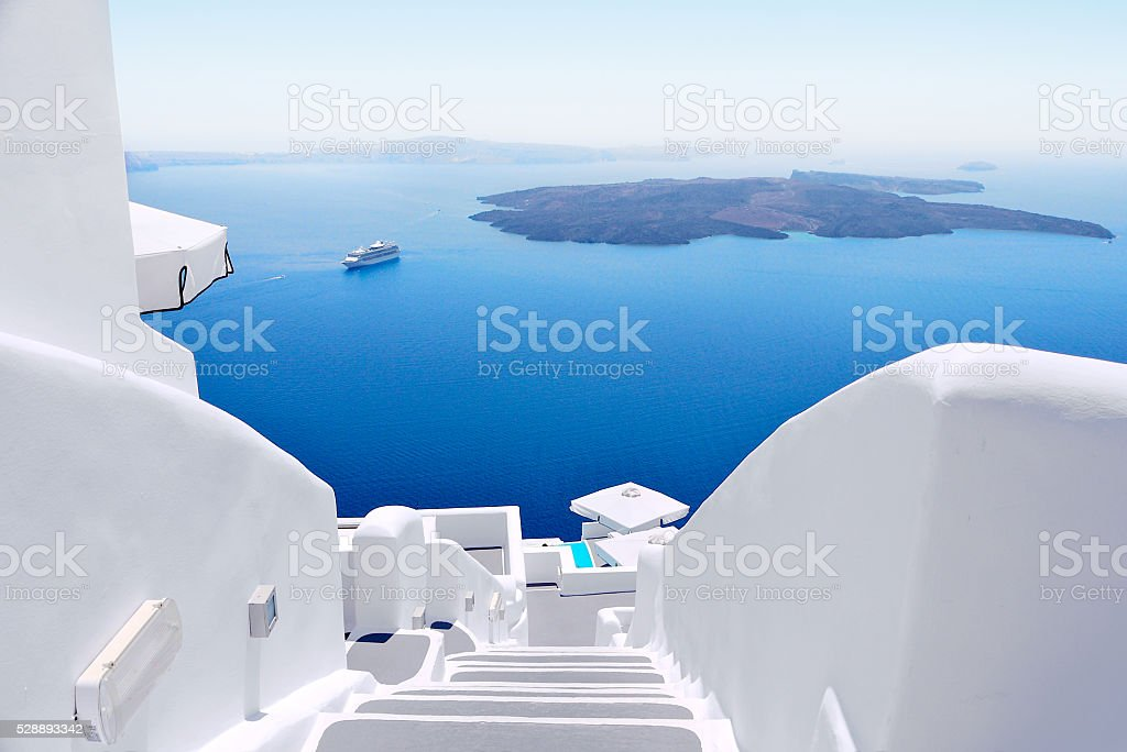 White staircases and Mediterranean sea viw on Santorini, Greece stock photo