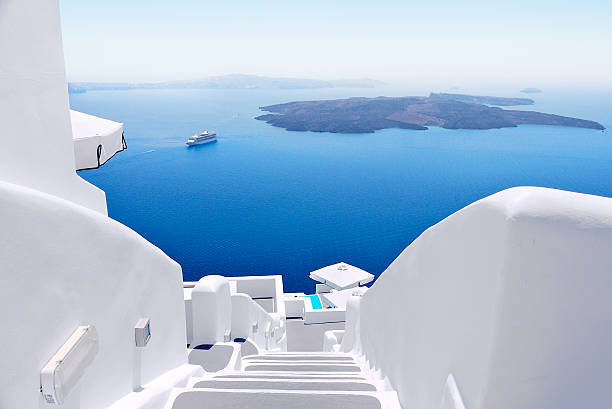 White staircases and Mediterranean sea view on Santorini, Greece White wash staircases on Santorini Island, Greece. The view toward Caldera sea with cruise ship awaiting. mediterranean sea stock pictures, royalty-free photos & images