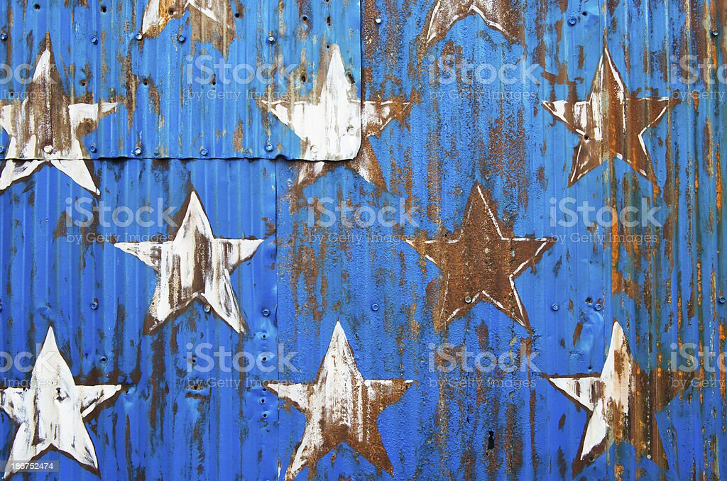 White Stars Painted on Blue Metal Wall Background Texture royalty-free stock photo