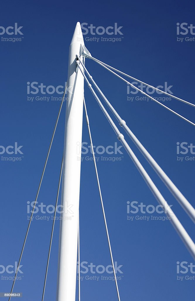 White steel bridge suspension wires against a clear blue sky royalty-free stock photo