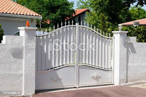istock white steel retro design metal aluminum gate of vintage house 1270186573