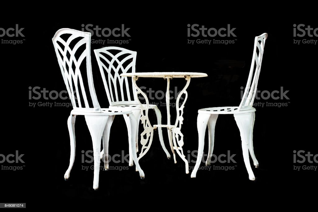 White Steel Table and Chair On a black background stock photo