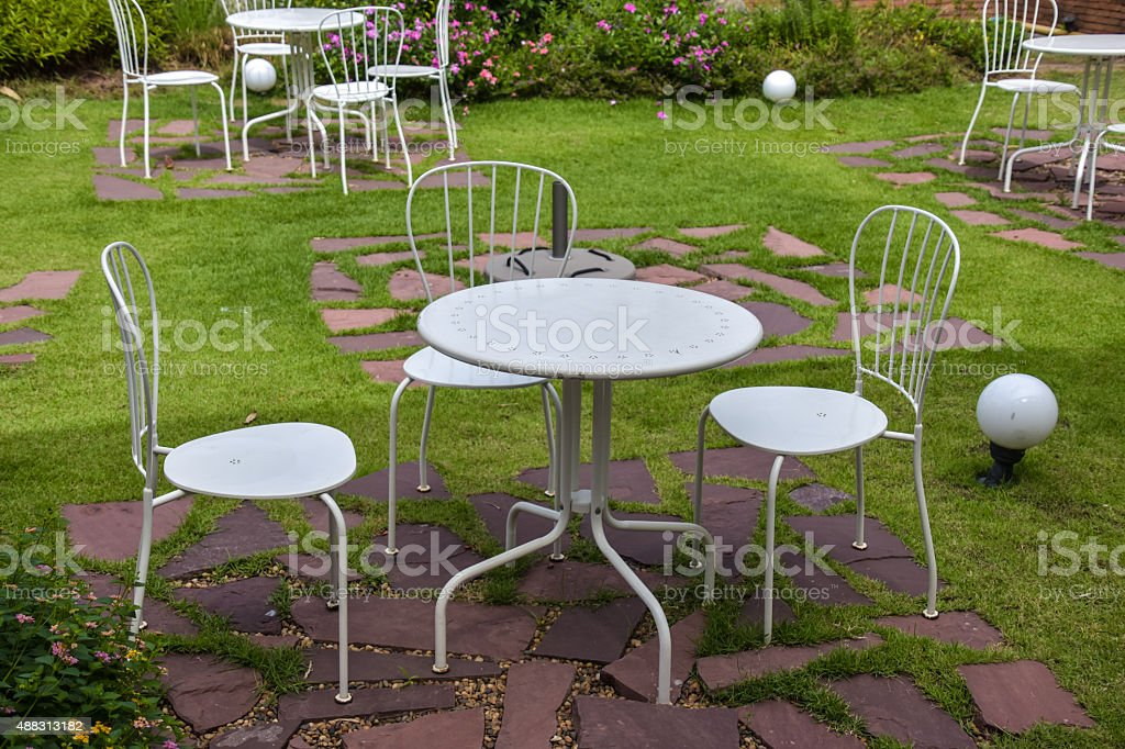 White steel table and chairs outside stock photo