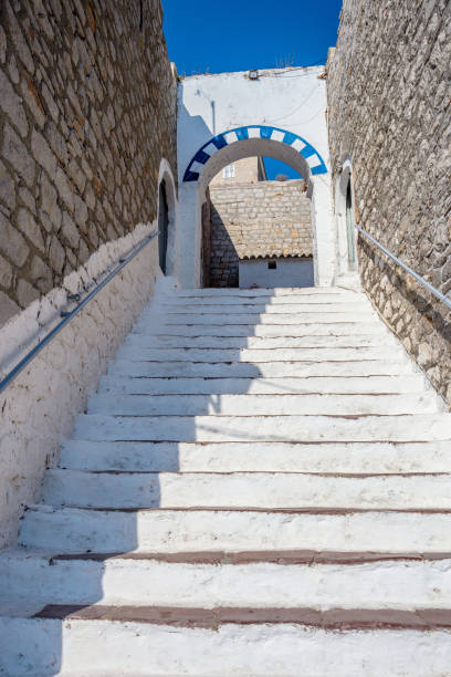 White steps. Narrow traditional white street in the town of Hydra, Hydra island, Greece stock photo
