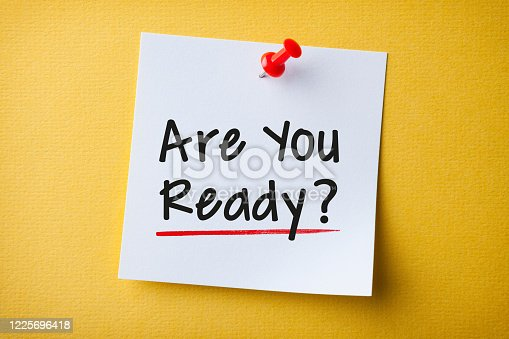 istock White Sticky Note With Are You Ready And Red Push Pin On Yellow Background 1225696418