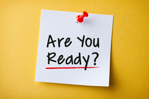 White Sticky Note With Are You Ready And Red Push Pin On Yellow Background