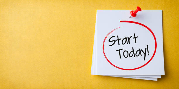 White Sticky Note With Start Today And Red Push Pin On Yellow Background stock photo