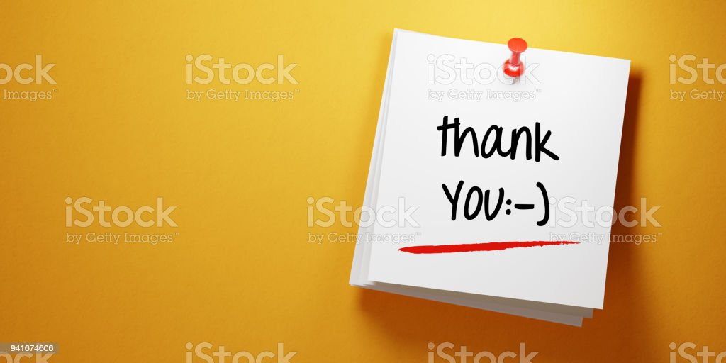 White Sticky Note With Thank You Message And Red Push Pin On Yellow Background stock photo