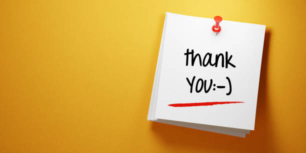 white sticky note with thank you message and red push pin on yellow background - thank you stock pictures, royalty-free photos & images
