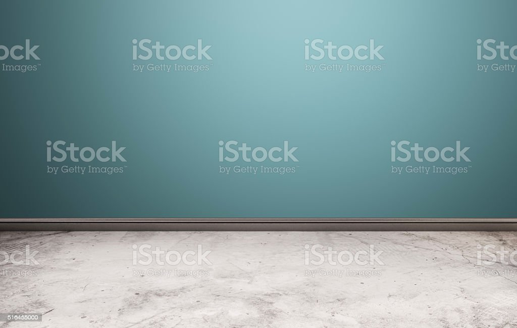 White stone floor with blue wall stock photo