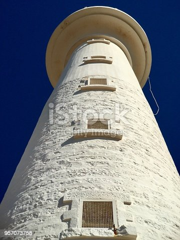 182416027 istock photo White stone lighthouse low angle view 957073758