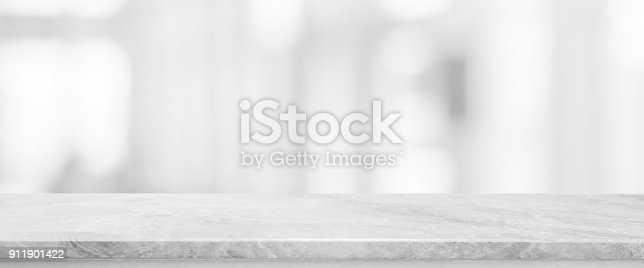istock White stone marble table top and blurred abstract background from interior building banner background - can used for display or montage your products. 911901422