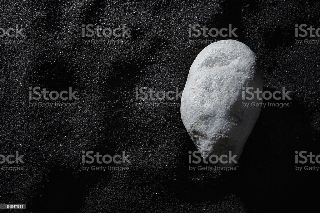 white stone on black beach stock photo