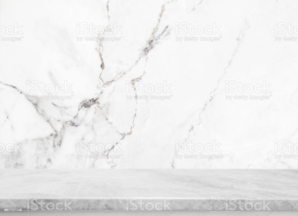 White stone table top and background of white marble stone wall - can used for display or montage your products.