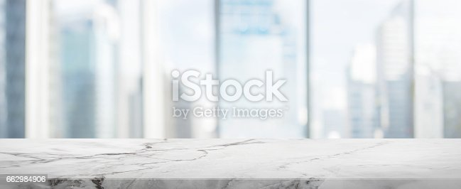 662984808 istock photo White Stone table top and blur glass window wall building banner background 662984906