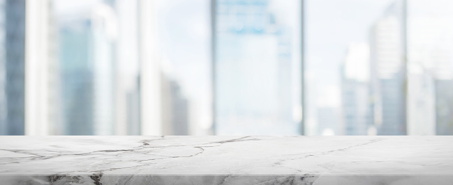 istock White Stone table top and blur glass window wall building banner background 662984906